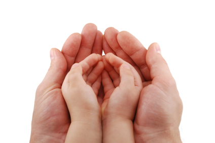 Man's hands hold kid's handful